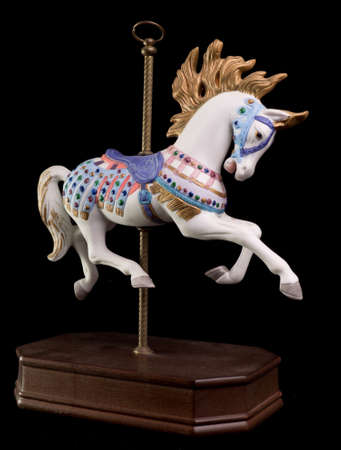 pony tail: Colorful carousel horse isolated on black background
