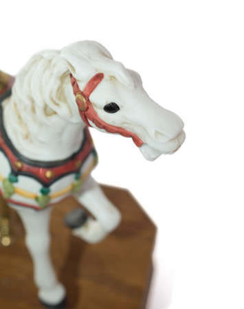 Minature Carousel Horse on white background photo