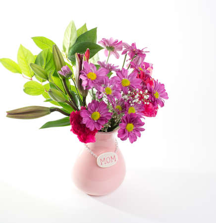 vase: Pretty pink flowers in pink Mothers Day vase for mom