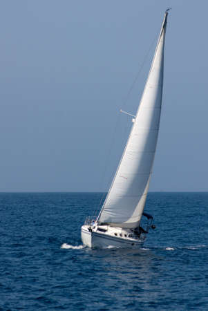 White sailboat underway