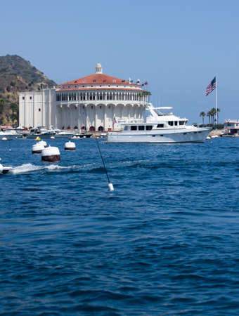 starboard: Starboard view of mega yacht in front of the historic Casino Building in Avalon Harbor, Catalina