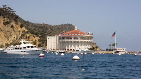 Starboard view of mega yacht in front of the historic Casino Building in Avalon Harbor, Catalina
