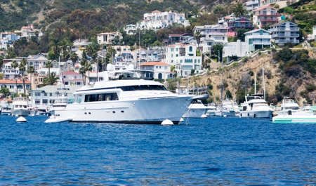 watercraft: Starboard view of mega yacht moored at Avalon Harbor, Catalina Island Stock Photo