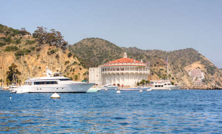 Starboard view of mega yacht in front of the historic Casino Building in Avalon Harbor, Catalina photo