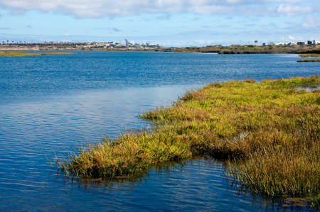 Scenic summer clouds over the Bolsa Chica Wetlands in Huntington Beach, California Stock Photo