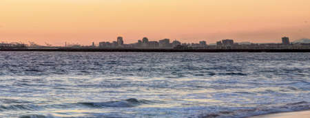 Long Beach cityscape and ocean at sunset photo