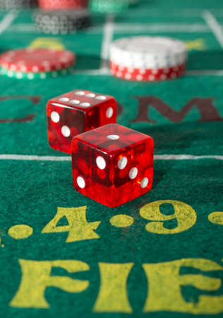 craps: Craps table with casino chips and dice Stock Photo