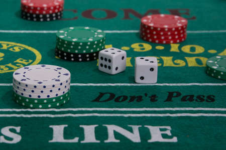 Craps table with casino chips and dice Stock Photo