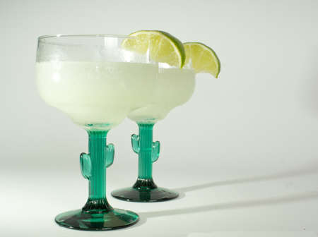 margaritas: Delicious frozen blended Mexican margarita with lime Stock Photo