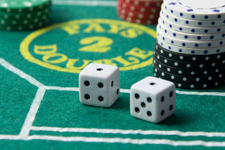 Craps table with casino chips and dice Editorial