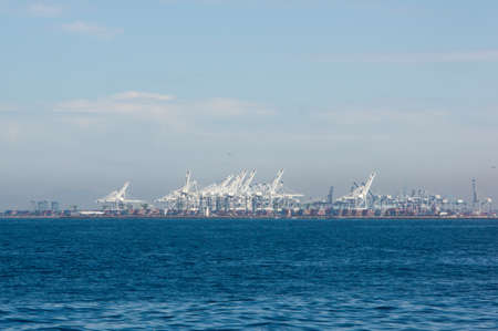 Shipping port viewed from offshore photo