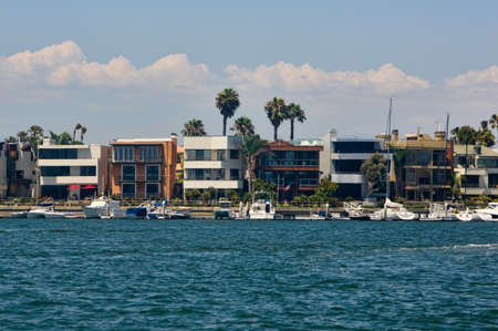 Waterfront homes and yachts at Los Alamitos Bay in Long Beach, California Stock Photo