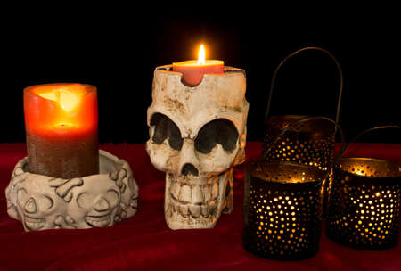 Day of The Dead  Dia de los Muertos  skull with flickering lighted candles Stock Photo