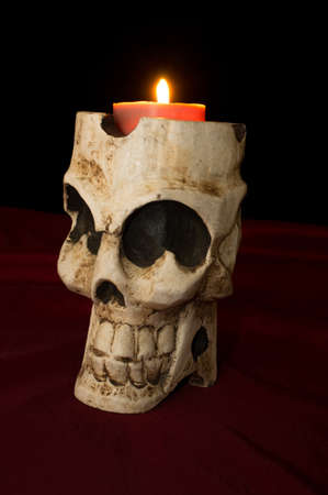 Day of The Dead  Dia de los Muertos  skull with flickering lighted candle photo