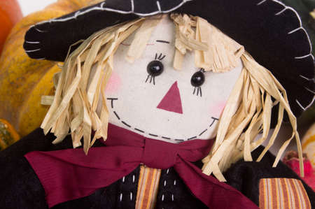 cinderella pumpkin: Close up view of straw stuffed scarecrow