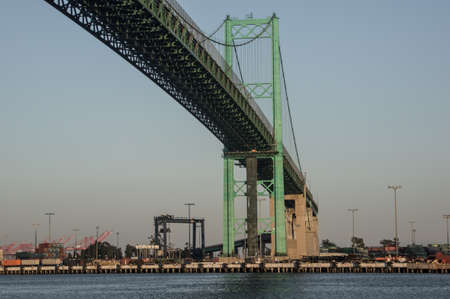 Historic Vincent Thomas Bridge located at the Port of Los Angeles one of the busiest shipping ports in the world photo