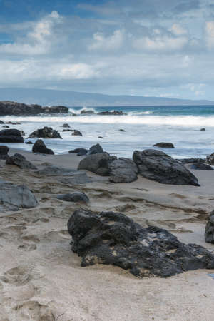 Rocky Maui shoreline with slow moving waves photo