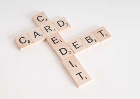 credit card debt: Credit Card Debt concept spelled in Scrabble letters. Isolated on white background.