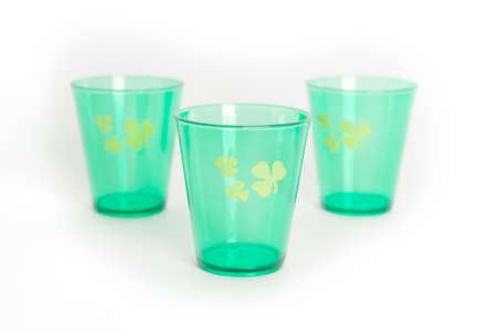 Green St. Patrick's Day shot glasses with shamrock isolated on white background Stock Photo - 17766746