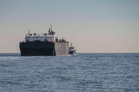 tug boat: Tug boat towing barge off the coast of Oxnard, California Stock Photo