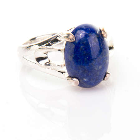 Blue lapis lazuli  cabachon gemstone ring isolated on white background.