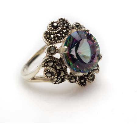 Sterling silver faceted mystic topaz round cut ring with marcasite. Isolated on white background with light shadow