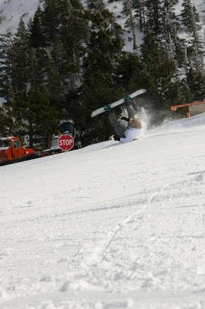 Snowboarder wipeout at Mt. Baldy Ski Resort. Stock Photo