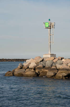 navigational light: Green nautical navigational light located at the entrance to Channel Islands Marina Stock Photo