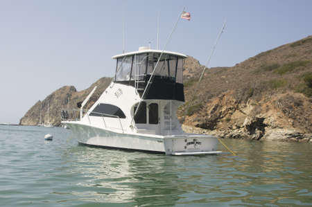 Named sportfisher yacht Crime Pays moored in Catalina Harbor on Santa Catalina Island. Property release included. Stock Photo