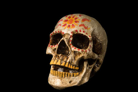 Hand painted Dia de los Muertos (Day of The Dead) skull isolated on black background