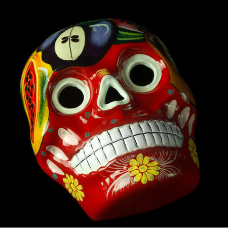 Colorful painted Day of The Dead (Dia de los Muertos) skulls isolated on black background Stock Photo