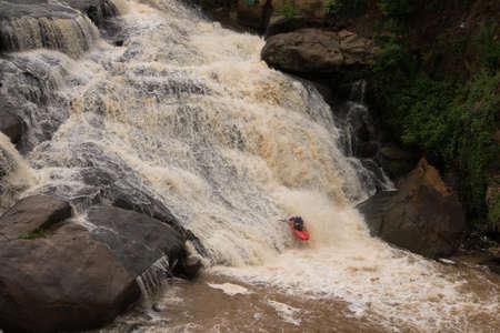 kayaker: Adventurous kayaker makes his way down the Reedy River at Falls Park in Greenville, South Carolina Stock Photo