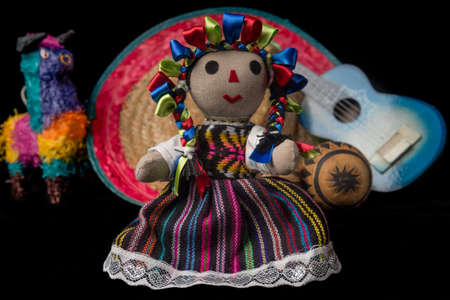 pinata: Mexican doll, pinata, guitar, hat, and maracas isolated on black background Stock Photo
