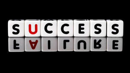 contradiction: Success spelled in dice letters with failure reflecting below  Isolated on black background  Stock Photo
