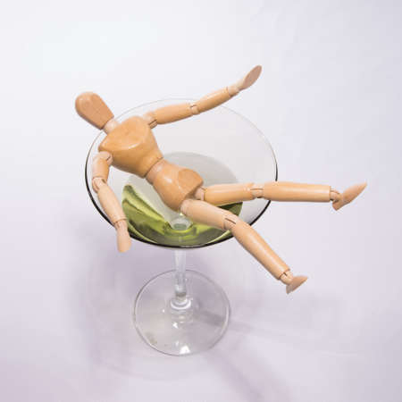 alcohol abuse: Alcohol abuse concept  Person falling in martini  cocktail glass