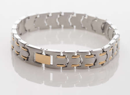 Mens stainless steel and gold bracelet
