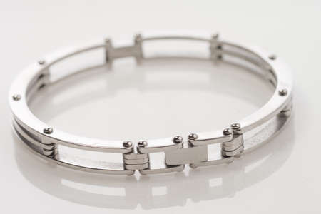 isoalated: Mens handcuff style stainless steel bracelet isoalated on white background Stock Photo