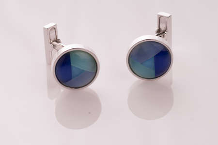 Cat's Eye cuff links isolated on white background with light reflection Stock Photo - 26109954