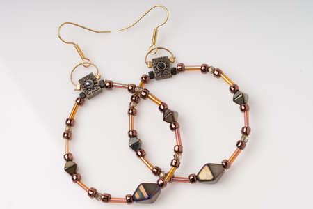 metalic: Bronze and copper metalic artisian beaded earrings. Isolated on white background