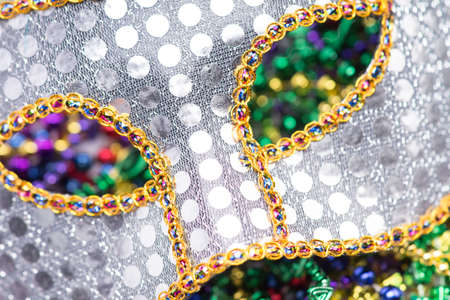 Colorful Mardi Gras Mask with beaded background photo