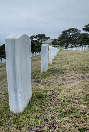 Abstract rows of gravestones honoring US veterans at Fort Rosecrans National Cemetary at Point Loma in San Diego, California Stock Photo