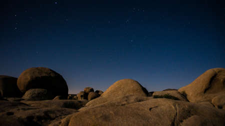 Rocks  lit by moonlight  under the Mlky Way at Joshua Tree National Park photo