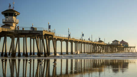 Huntington Beach Pier reflecting on beach photo