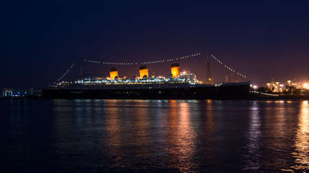 Queen Mary at night docked at the Port of Long Beach