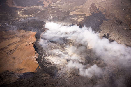 erupt: Pahoa, Hawaii, USA, 28 October, 2014. Kilauea lava flow threatens residents of Hawaii. The June 27 lava flow from Poo Uu vent flows into the town of Pahoa. Editorial