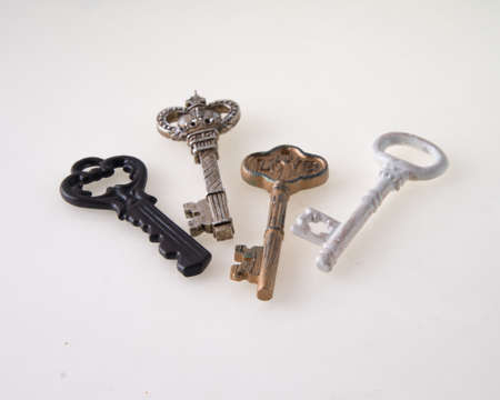 Concept image key to my heart with several antique keys isolated on white background