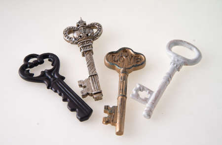 antique keys: Concept image key to my heart with several antique keys isolated on white background