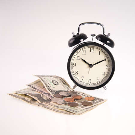 Concept image time equals money with money and clock isolated on white background