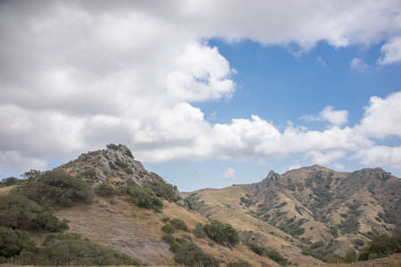 back country: Scenic view of rugged mountains and white clouds in the back country of Santa Catalina Island Stock Photo