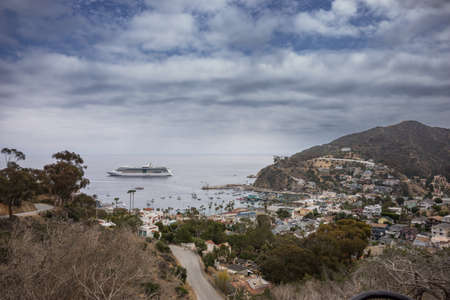 catalina: Cruise ship moored off the coast of Avalon Harbor on Santa Catalina Island. With scenc view of Avalon Bay from above.
